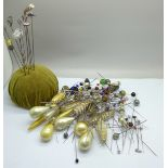 A pin cushion with nine silver hat pins including Charles Horner and other hat pins