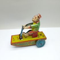 A 1960's clockwork tin-plate 'Banana Joe' toy, marked made in England