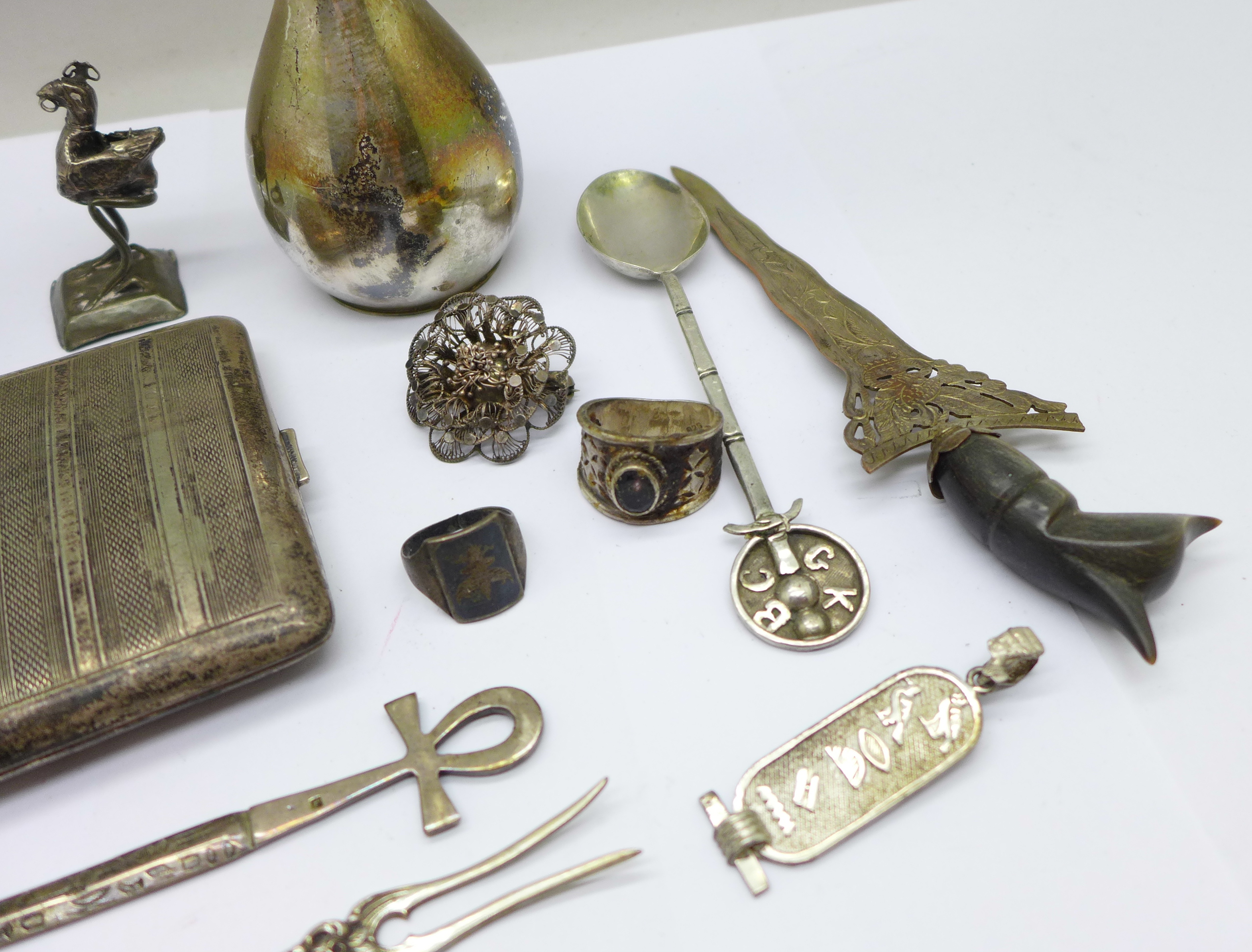 A collection of continental silver including a cigarette case, jug, rings, spoon, etc., 280g - Image 2 of 7