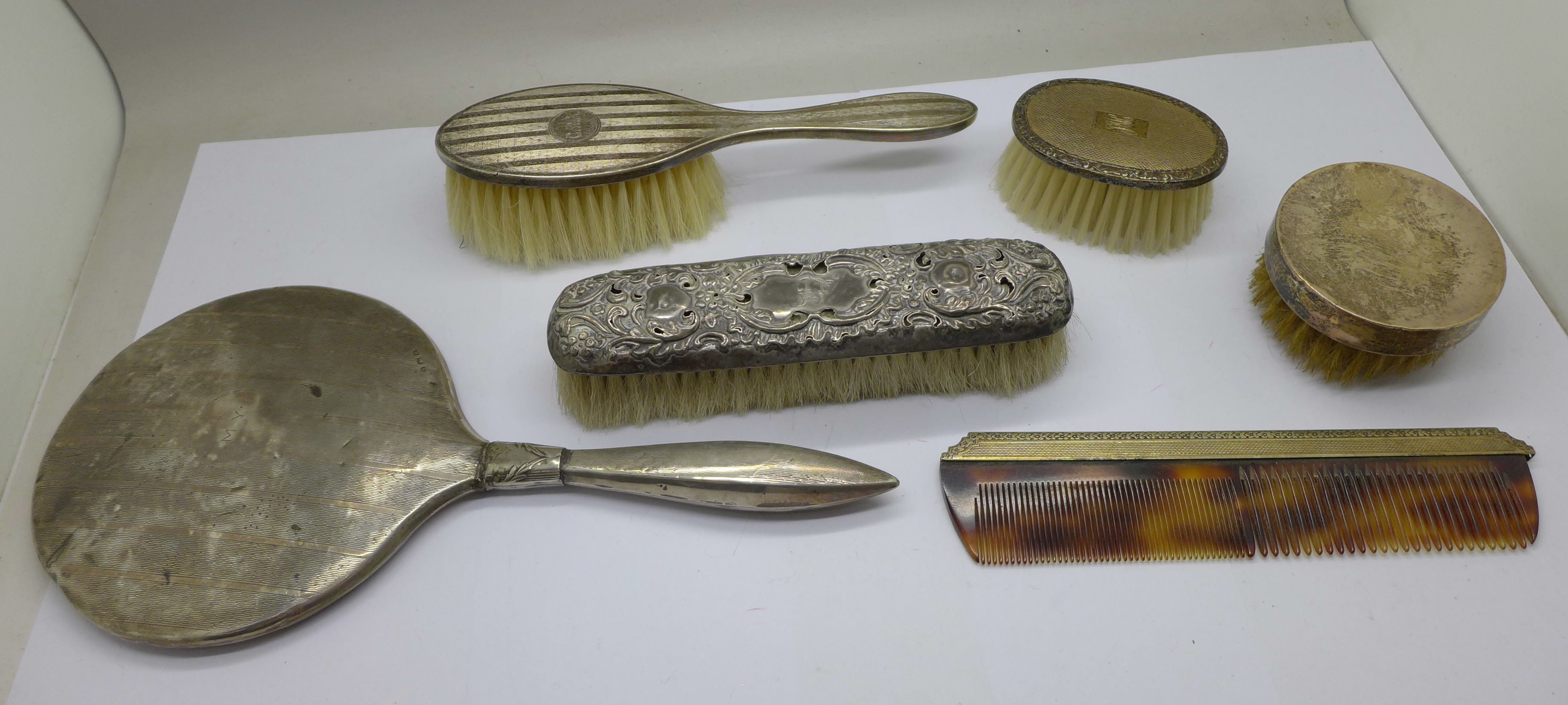 Silver brushes (two cased), comb and a hand mirror