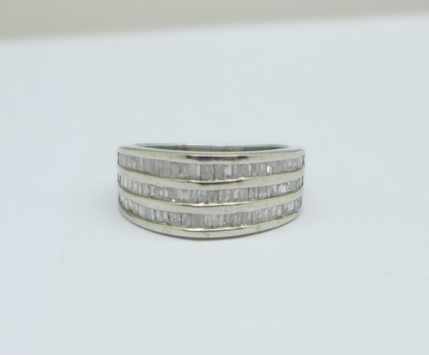 A 9ct white gold and three row Art Deco style diamond ring, 4.8g, M