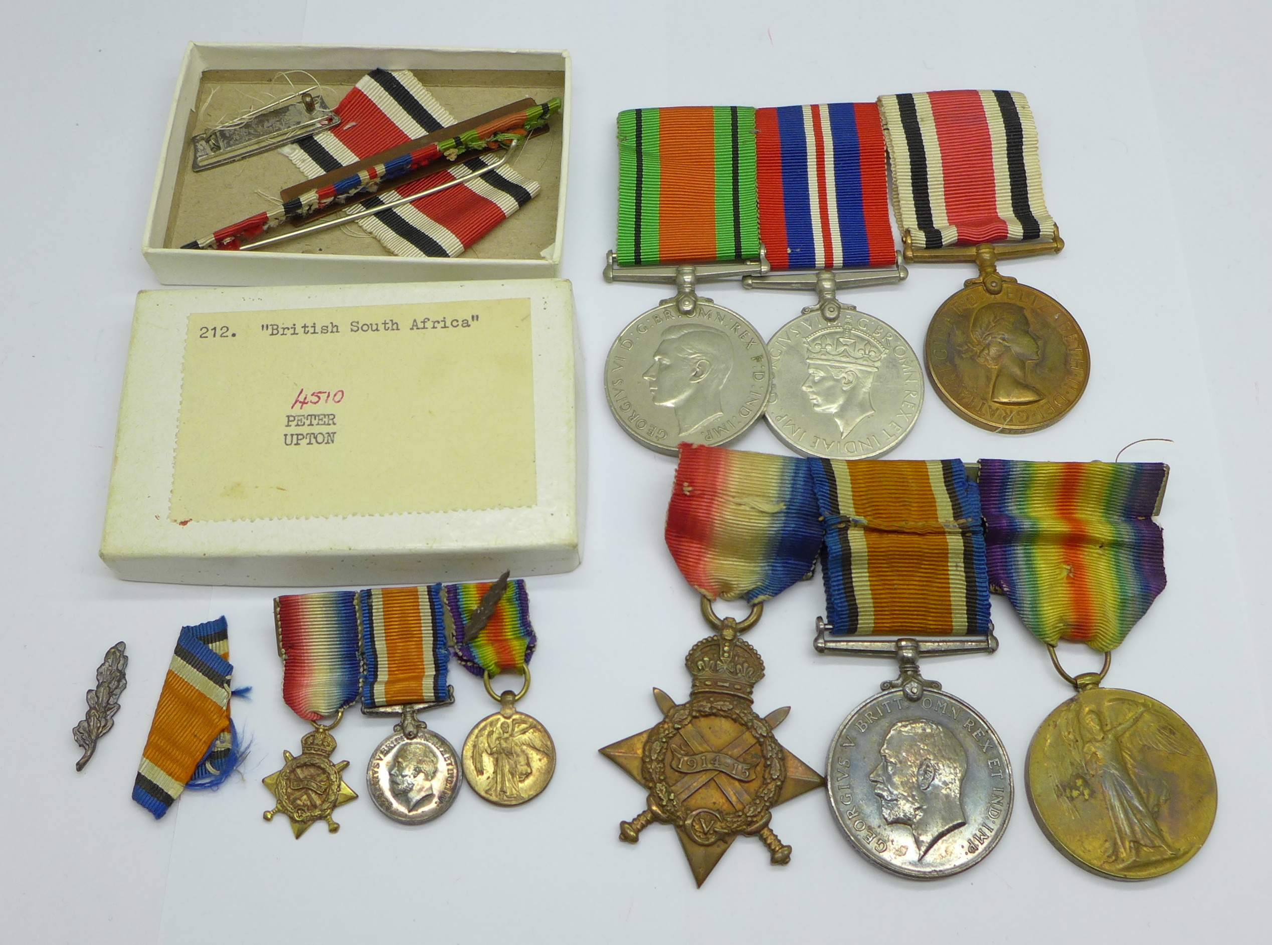 A family group of medals, three WWII medals including Special Constable, a trio of WWI medals to