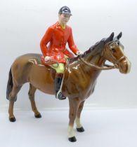 A Beswick huntsman on horseback
