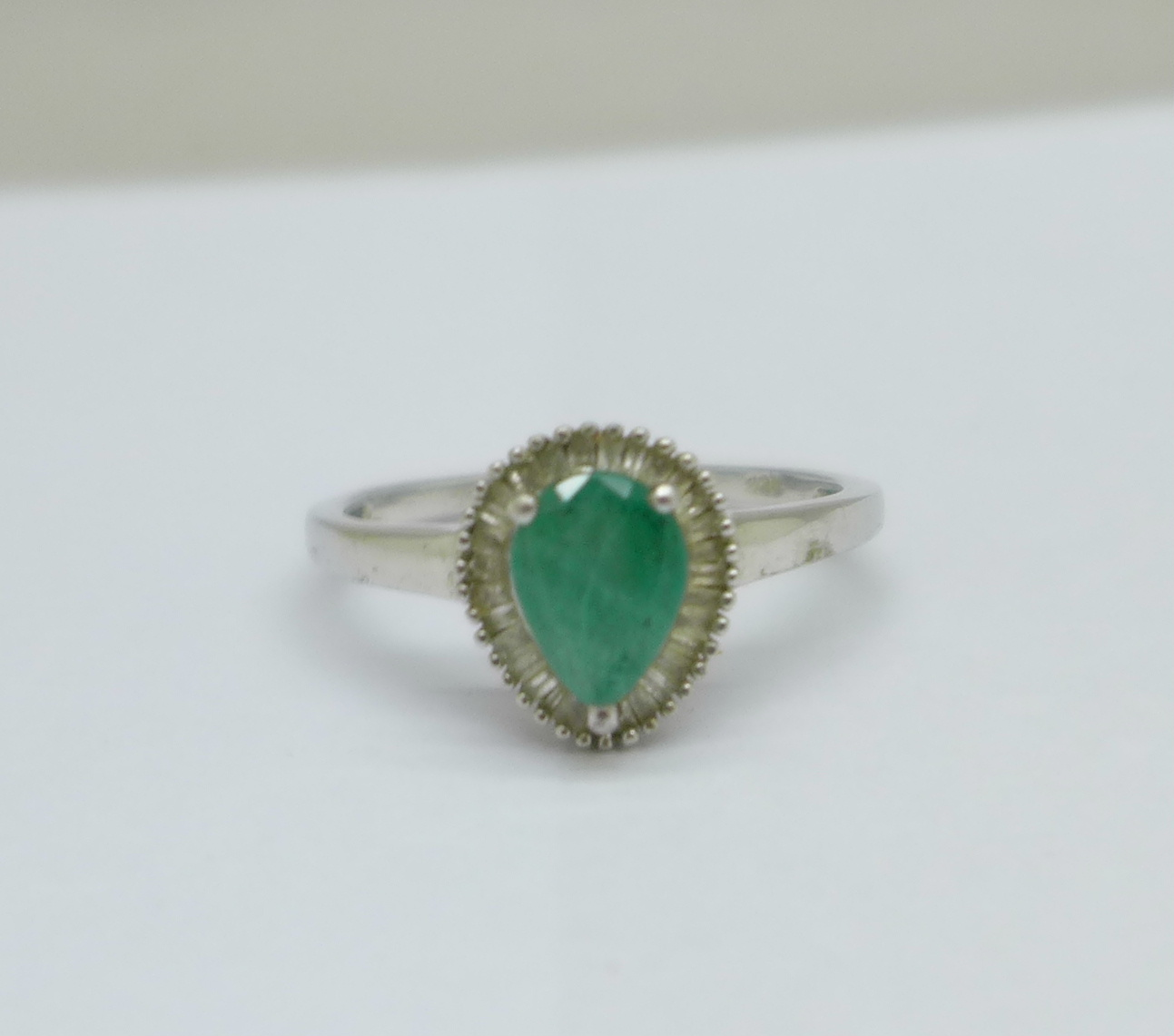 A silver, emerald and diamond set ring, T/U