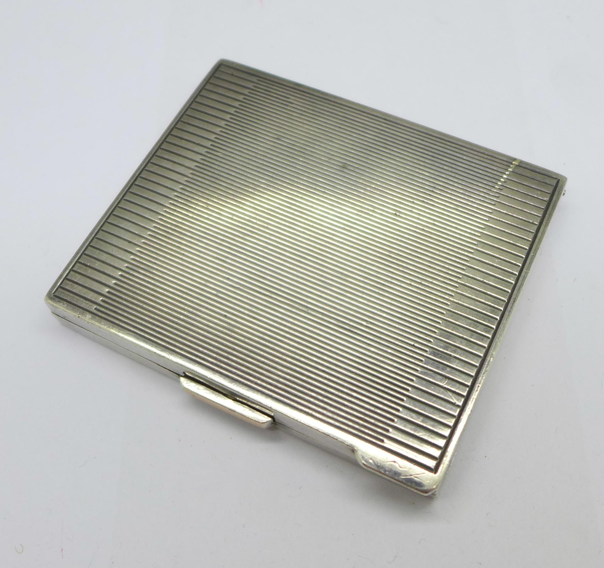 An Art Deco silver compact, London 1945, 80g