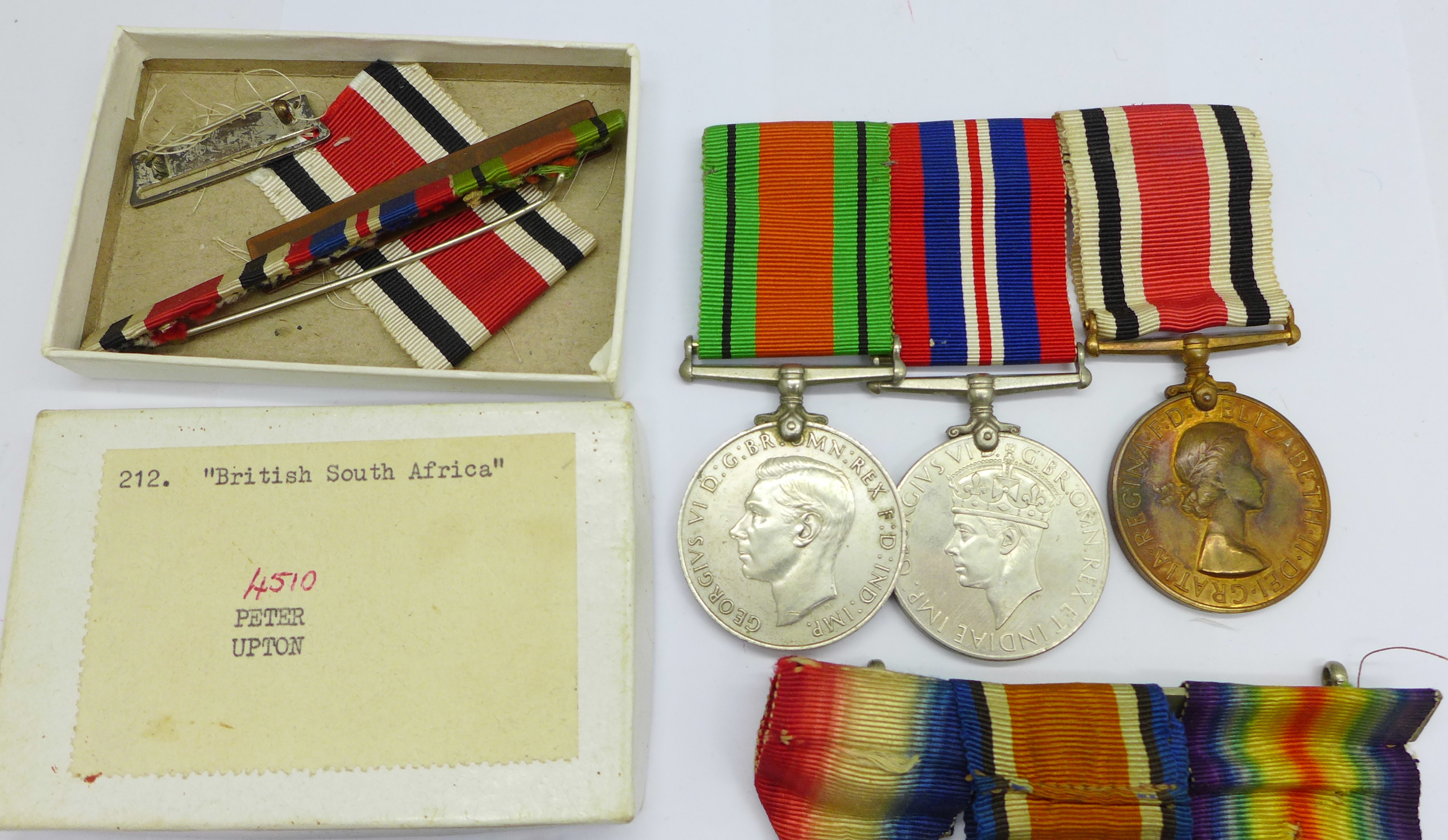 A family group of medals, three WWII medals including Special Constable, a trio of WWI medals to - Image 3 of 6