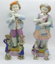A pair of continental figures, a pair of miniature figures, one other miniature figure and a pin
