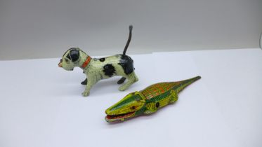A tin-plate clockwork toy alligator and a clockwork toy dog, the dog marked made in Germany