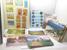 A collection of postcards and a stamp album