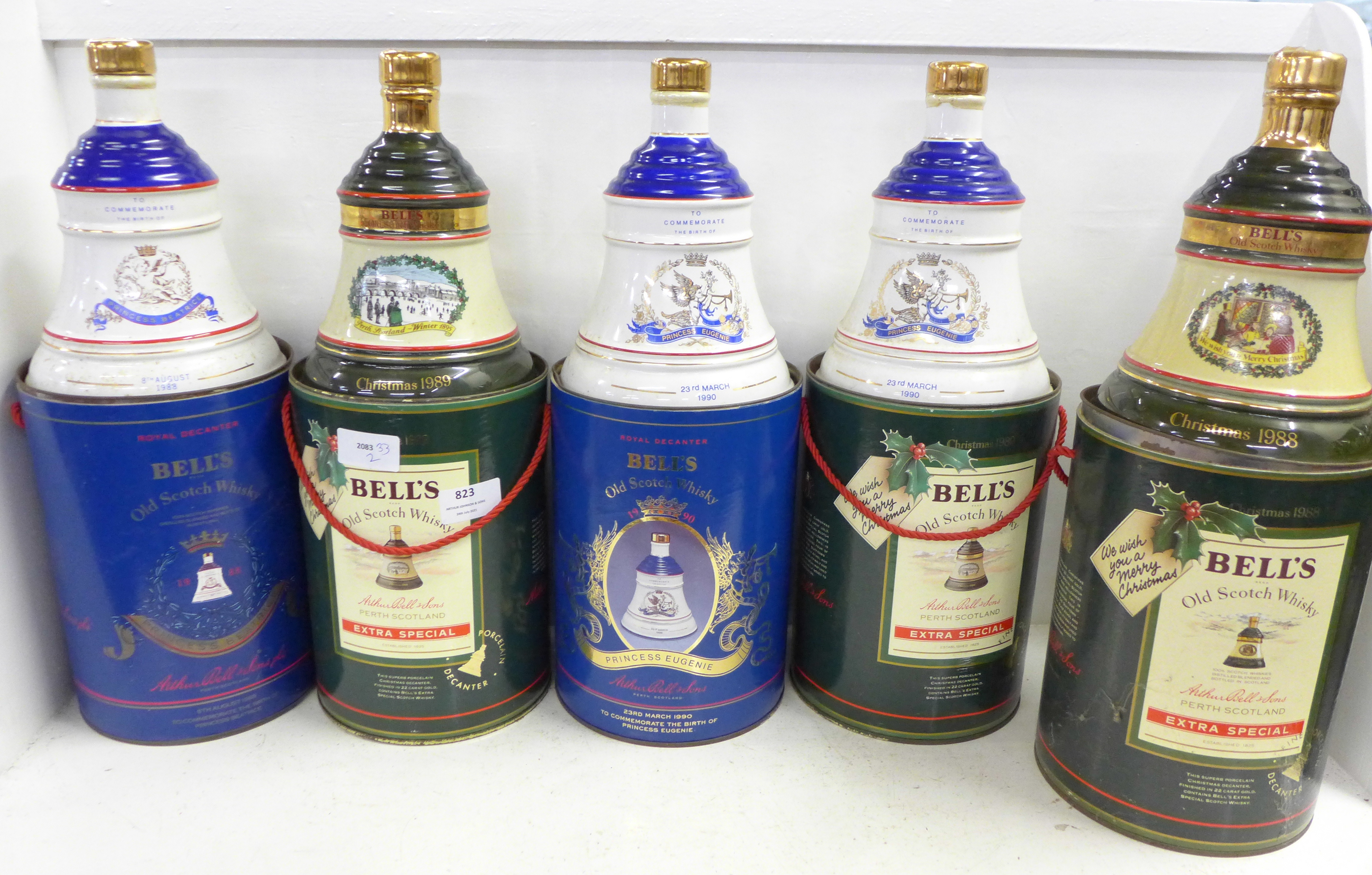 Five Bell's Old Scotch Whisky decanters in containers; three Extra Special