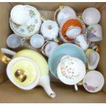 A yellow bone china tea set comprising six cups, six saucers, a milk jug, sugar bowl and tea pot,