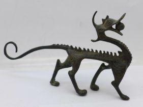 A Chinese bronze dragon brush rest, 15cm