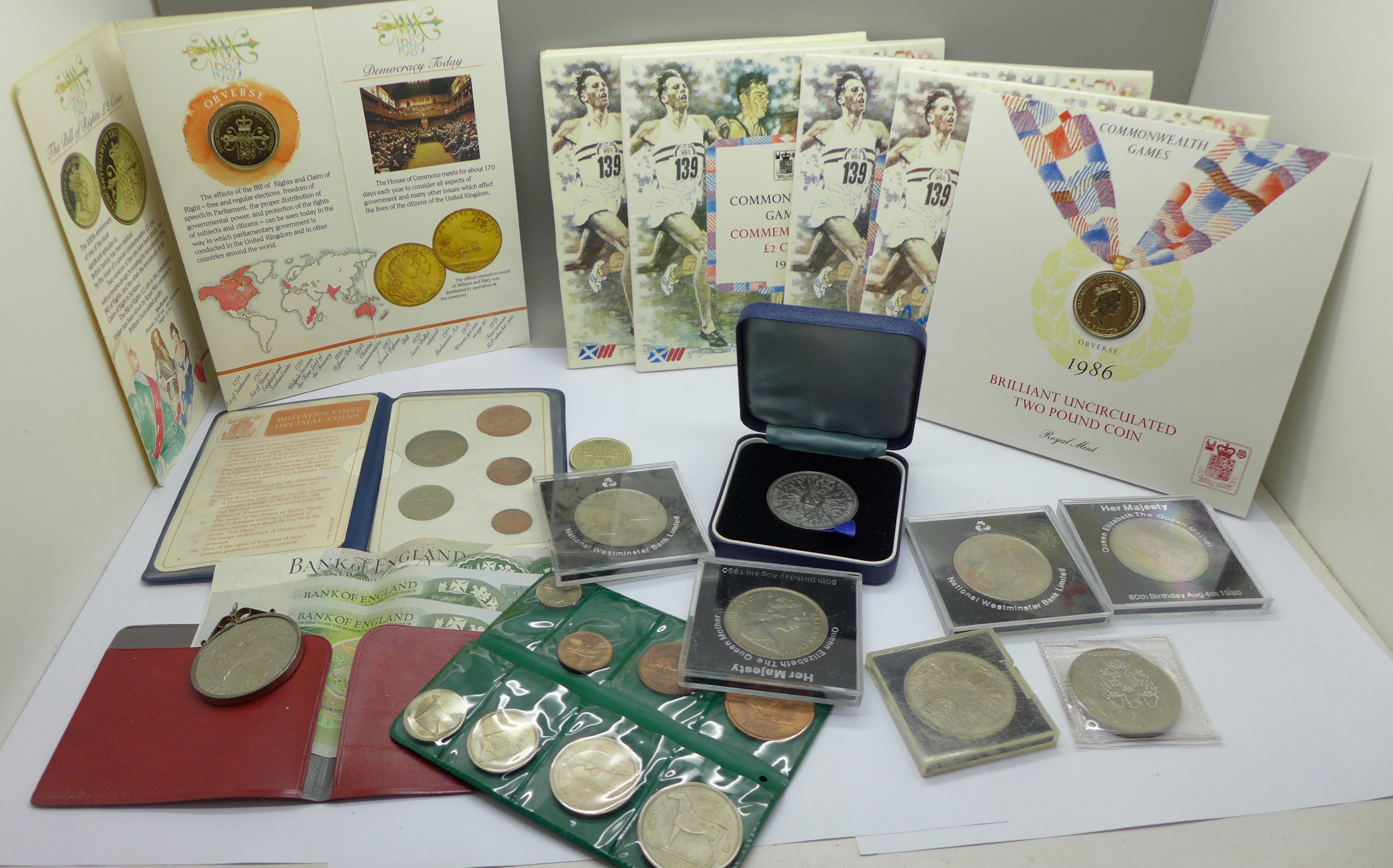 Four £2 commemorative coins from the 1986 Commonwealth Games, a collection of other commemorative