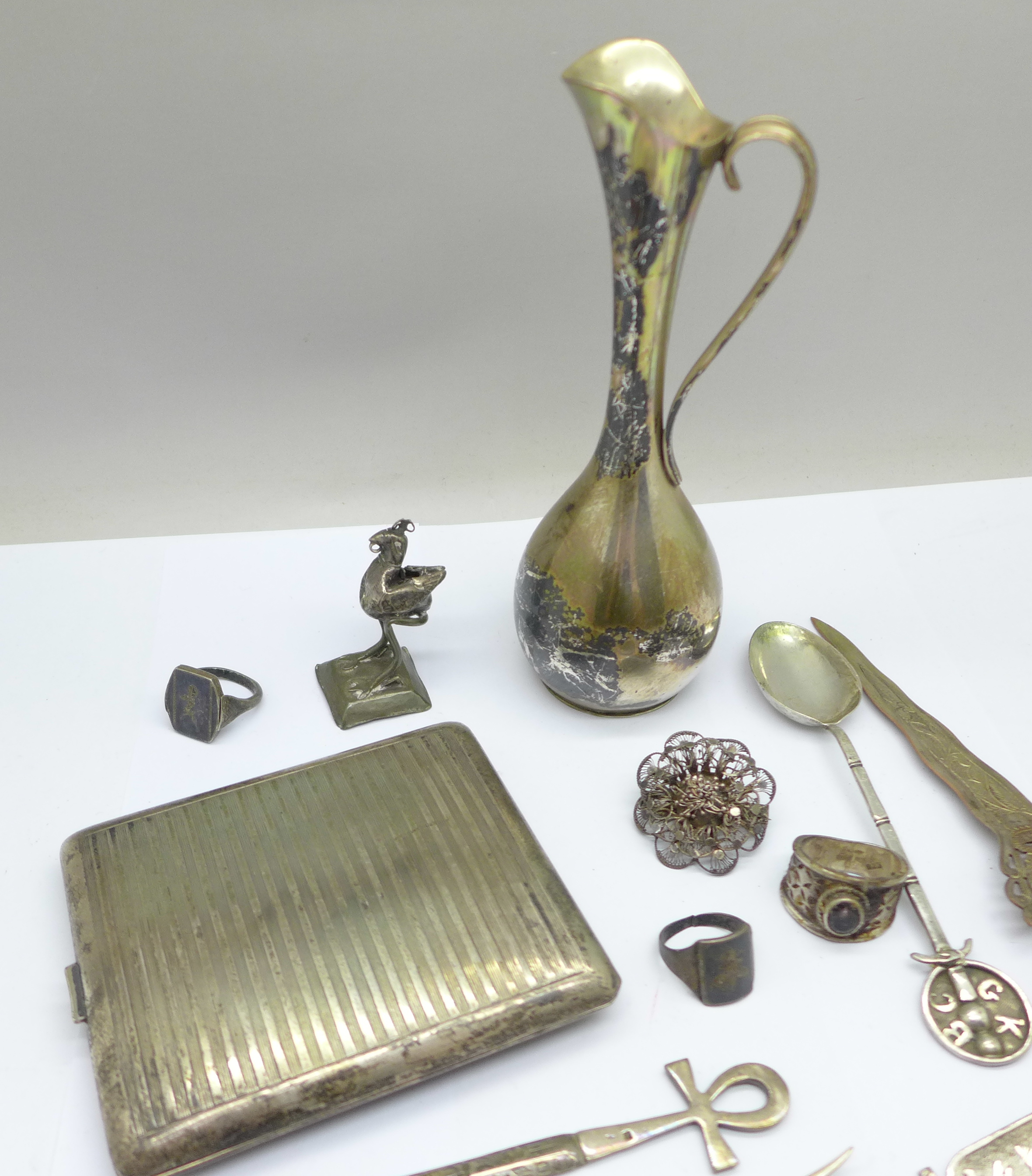 A collection of continental silver including a cigarette case, jug, rings, spoon, etc., 280g - Image 6 of 7