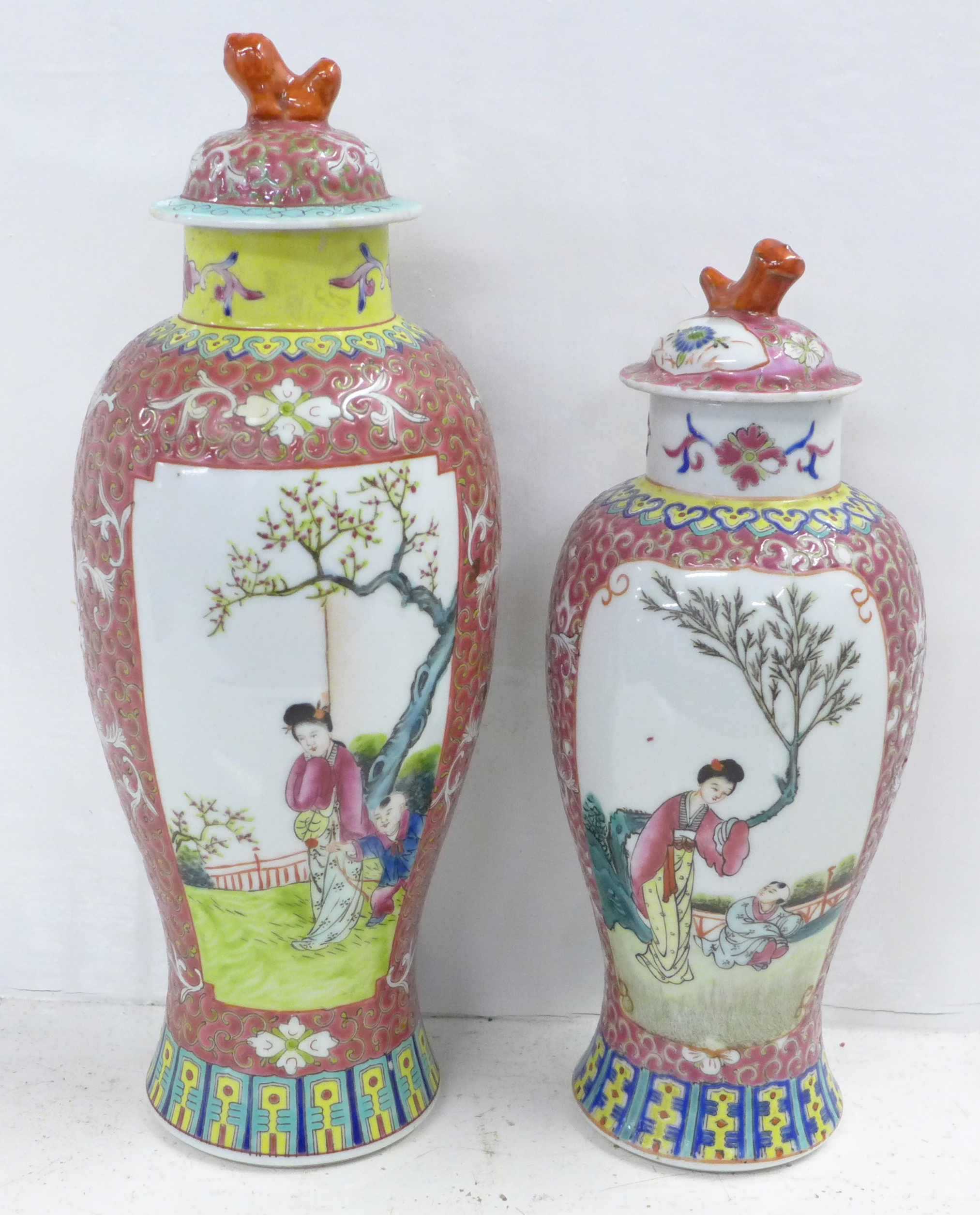 Two famille verte jars with covers