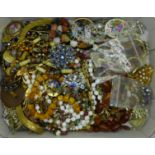 A collection of costume jewellery including brooches, beaded necklaces, earrings, etc.