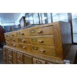 An oak twelve drawer index drawer cabinet