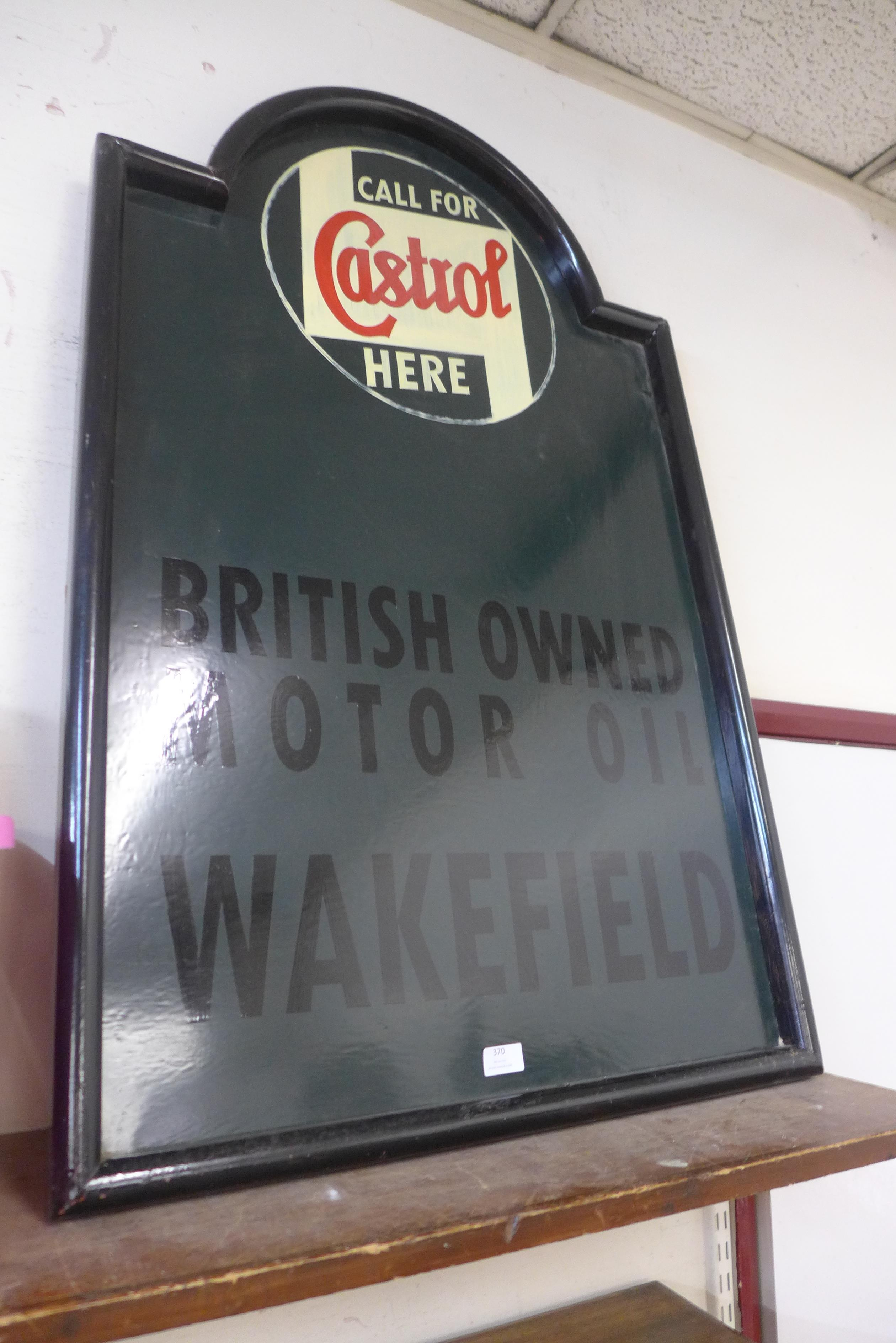 A painted Castrol advertising sign