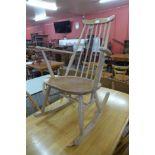 An Ercol Blonde elm and beech Goldsmith rocking chair