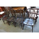 A set of beech and elm wheelback kitchen chairs