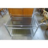 A chrome and glass trolley
