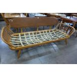 An Ercol Blone elm and beech 355 model studio couch