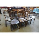 A set of nine Victorian beech and elm Windsor kitchen chairs