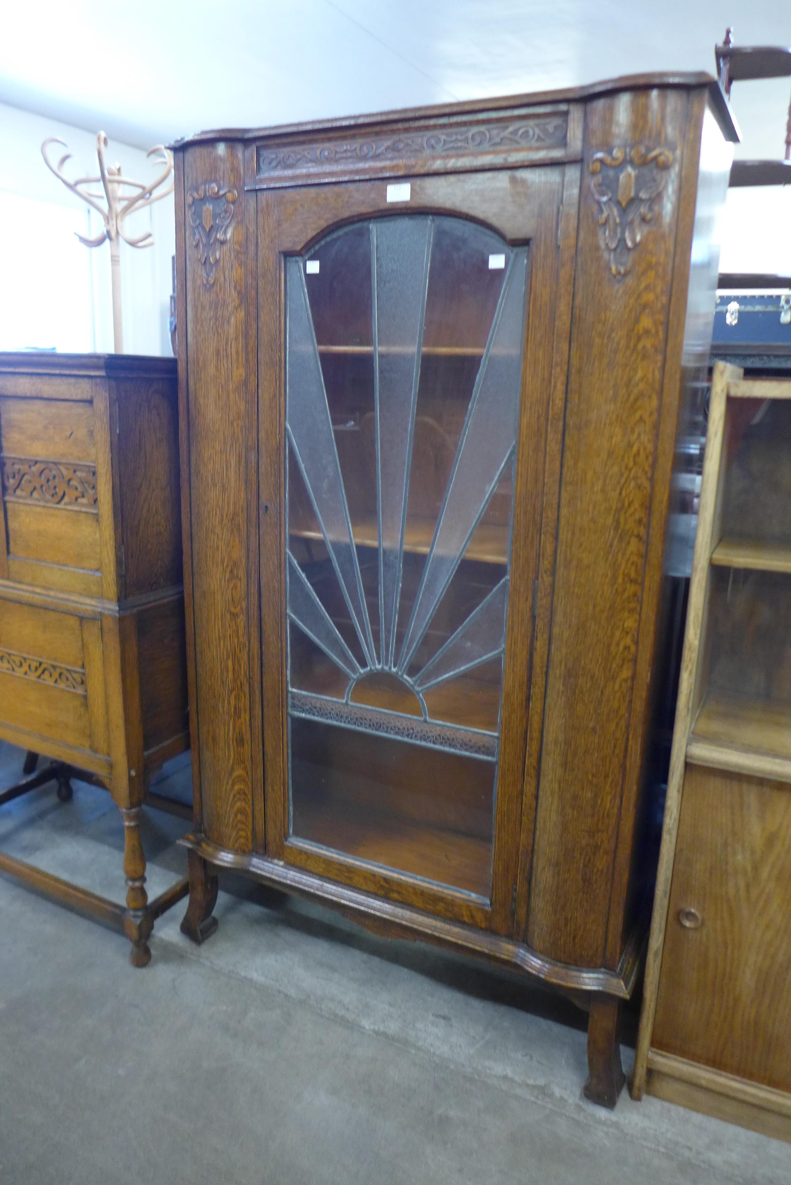 A carved oak bookcase