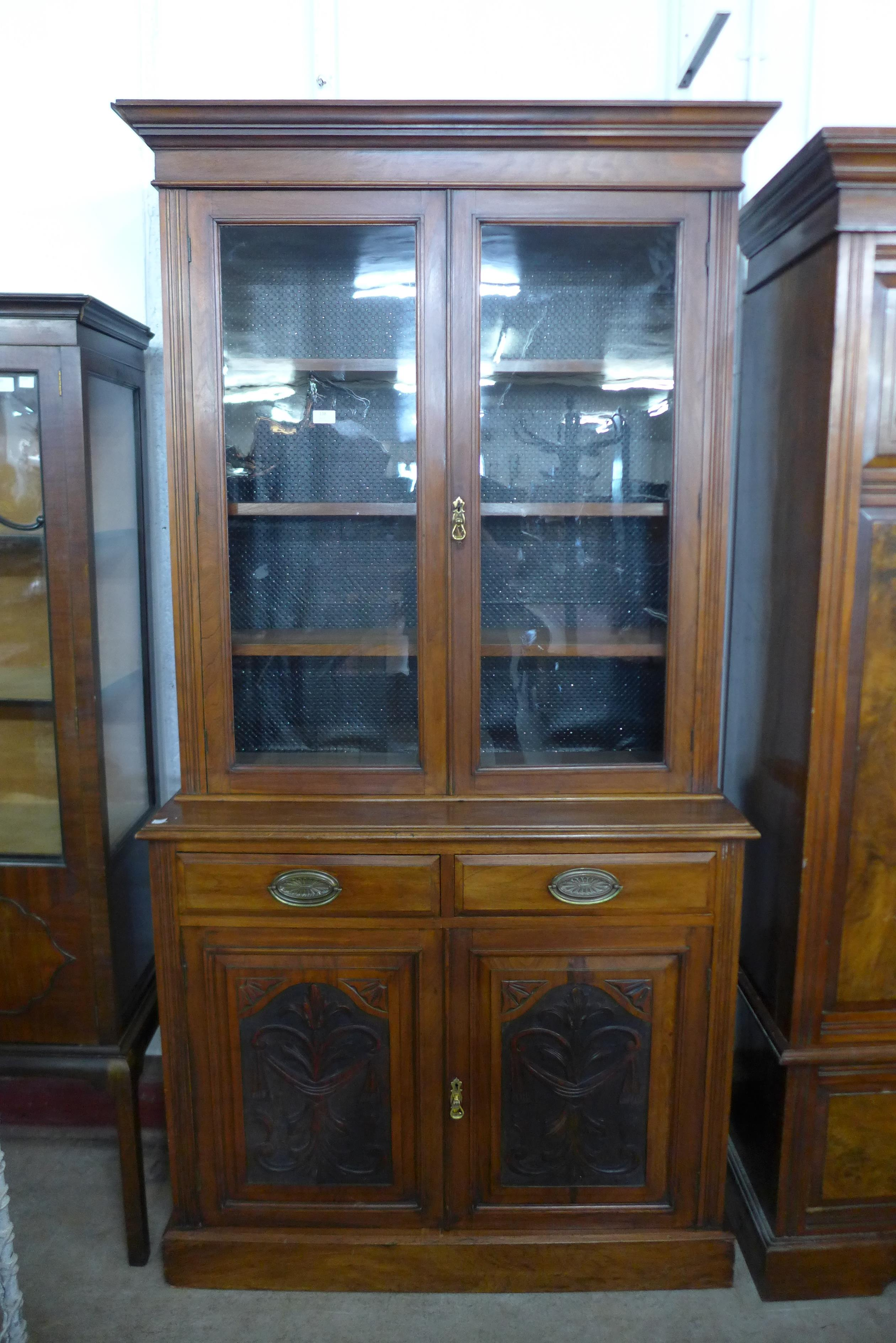 A Victorian carved walnut bookcase
