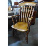 A Victorian beech farmhouse armchair