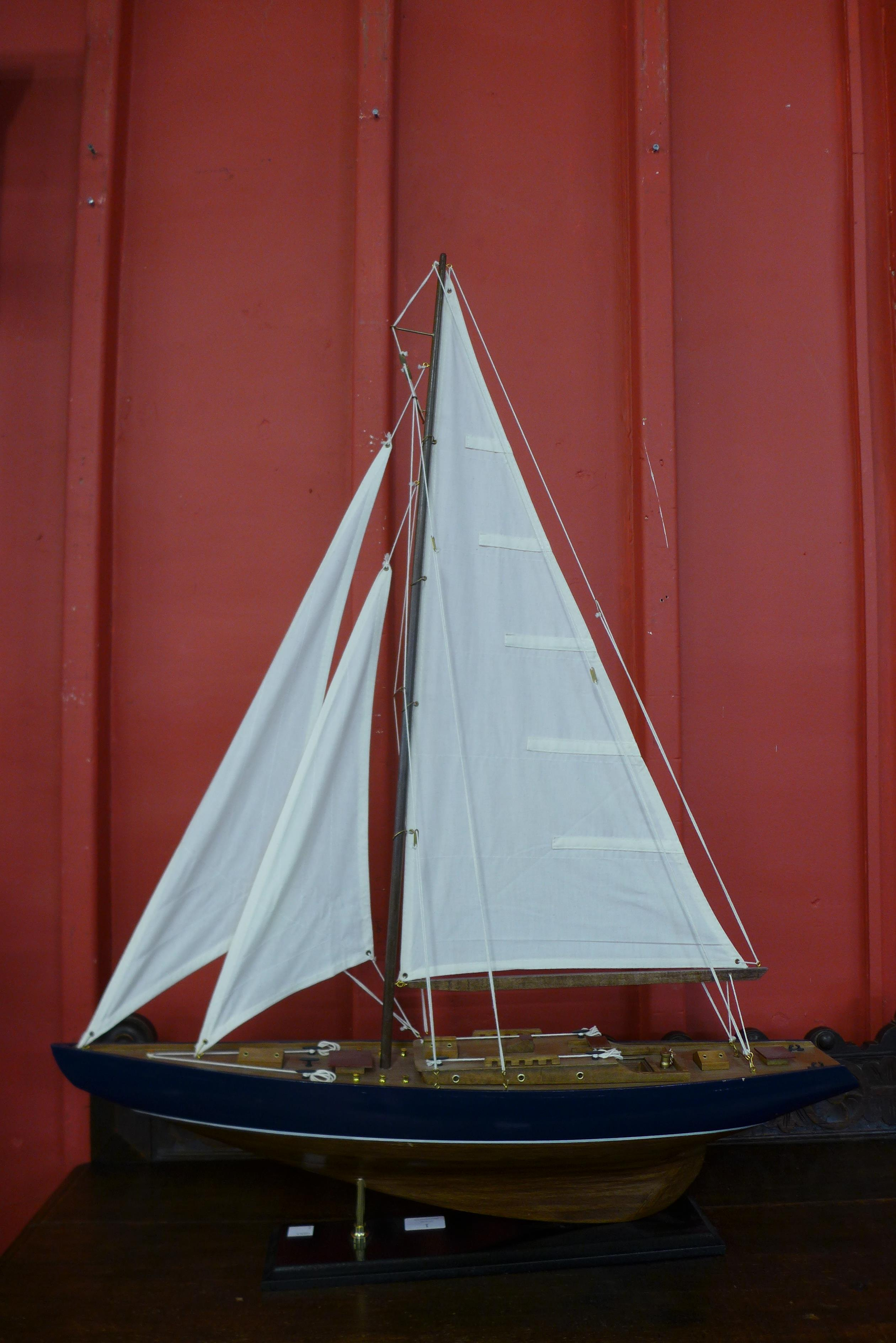 A scale model of a fully rigged yacht