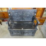 A Jacobean Revival carved oak monk's bench