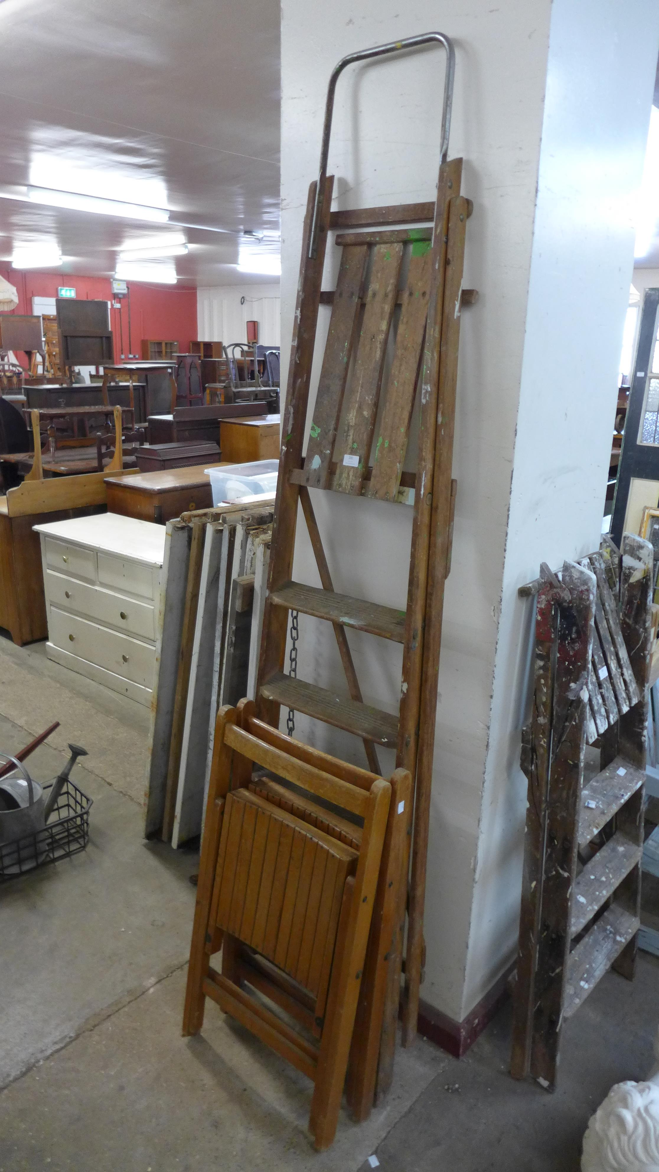 A set of stepladders and two folding chairs