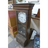 An early 20th Century oak cased time recorder