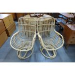 A pair of bamboo lounge chairs