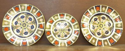 Two Royal Crown Derby Old Imari dinner plates, 27cm, and a side plate, 21.5cm, second quality