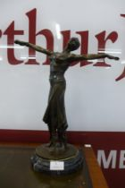 An Art Deco style bronze figure of an exotic female dancer, on black marble socle