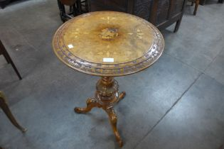 A Victorian carved walnut and marquetry inlaid tripod table
