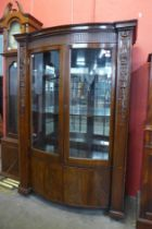 A Hepplewhite Revival carved mahogany two door bow front side cabinet