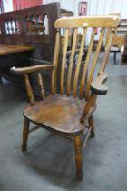 A Victorian elm and beech farmhouse armchair
