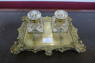 A Victorian ormolu desk stand, with two cut glass inkwells