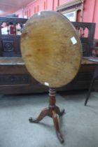 A George III oak and mahogany circular tilt top tripod table