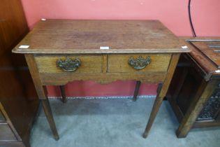 A George III oak two drawer side table