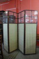 An Edward VII mahogany four fold dressing screen