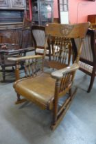 An American Arts and Crafts carved oak rocking chair