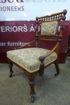 An Arts and Crafts carved walnut lady's chair