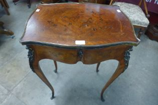 A 19th Century French Louis XV style marquetry inlaid rosewood and ormolu mounted occasional table