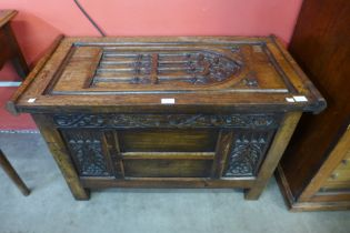 A small Gothic Revival oak coffer