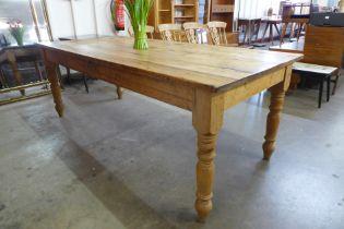 A large pine farmhouse kitchen table