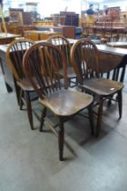 A set of four 19th Century ash and elm Windsor kitchen chairs